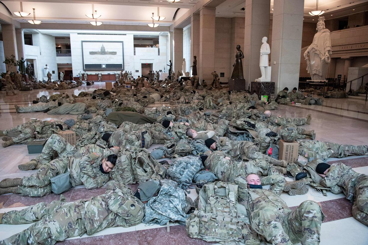 Members of the National Guard rest in the Capitol visitor's center on Capitol Hill,