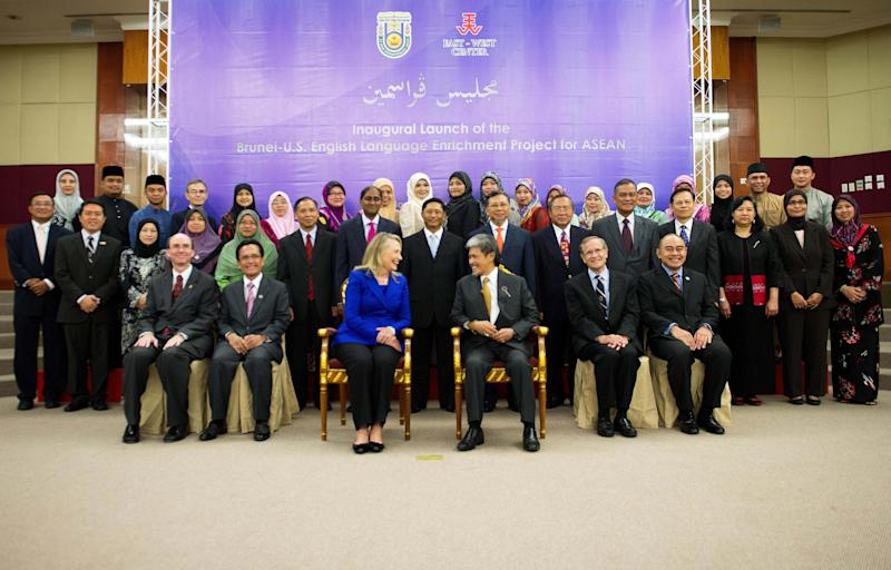 U.S. Secretary of State Hillary Rodham Clinton, center left, and Brunei's Foreign Minister Prince Mohamed Bolkiah, center right, pose for a family photo for the inaugural launch of the Brunei-U.S. English Language Enrichment Project for ASEAN at Universiti Brunei Daussalam in Bandar Seri Begawan, Brunei, Friday, Sept. 7, 2012. (AP Photo/Jim Watson, Pool)