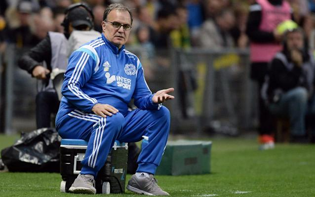 "Marcelo Bielsa, the former Argentina and Chile coach, has emerged as a shock candidate to take over at Leeds United as the club search for their 10th manager in less than three years following the sacking of Paul Heckingbottom. Heckingbottom, 40, replaced Thomas Christiansen in February but, after winning just four of his 16 matches in charge, Leeds finished 13th in the Championship, 15 points adrift of the top six, and the club now want to appoint a head coach ""with more experience"". Leeds are thought to have made initial contact with Bielsa, who left French club Lille in December. It is unclear whether the 62-year-old Argentine, who spent six years in charge of his native Argentina and four years coaching the Chile national team, before taking club jobs with Athletic Bilbao, Marseille and Lazio, would be prepared to move to England for the first time. Batigol: Bielsa with Argentinian striker Gabriel Batistuta in 2000 Credit: AP But the prospect of Bielsa, and whom Pep Guardiola and Mauricio Pochettino cite as an influence, taking the helm at Elland Road would surprise and intrigue in equal measure. Angus Kinnear, Leeds' managing director, said they were ""confident of making a quick appointment"". Other candidates are also being considered. England Formation Builder ""Our objective is to bring in a head coach with more experience who can help us reach the goals we have talked about since we became custodians of the club last summer,"" Kinnear said. Only one of Leeds' past eight managers – Garry Monk in 2016-17 – has lasted a whole season in charge. Leeds had activated a £500,000 release clause in Heckingbottom's contract at Barnsley in order to appoint him. Heckingbottom's assistant, Jamie Clapham, the former Leeds defender, also departs along with head of fitness Nathan Winder, and analyst Alex Bailey. Gianni Vio – the club's set-piece coach who was recruited prior to Heckingbottom's arrival – is not having his contracted renewed."