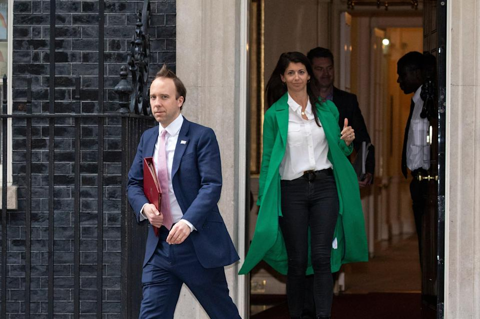 Matt Hancock leaving Downing Street with aide Gina Coladangelo in May (Getty Images)
