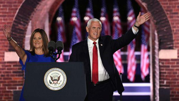 PHOTO: Vice President Mike Pence arrives with wife Karen Pence before speaking during the third night of the Republican National Convention at Fort McHenry National Monument in Baltimore, Aug. 26, 2020. (Saul Loeb/AFP via Getty Images)