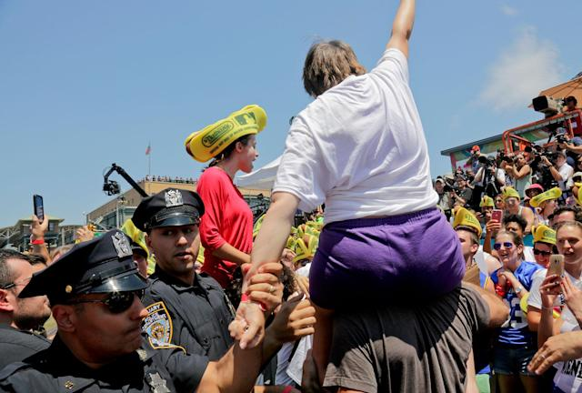 <p>Police remove animal rights activists as they try to protest at the Nathan's Annual Famous International Hot Dog Eating Contest won by Joey Chestnut, Tuesday July 4, 2017, in New York. (AP Photo/Bebeto Matthews) </p>