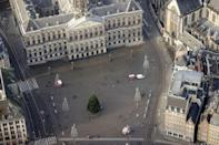 Amsterdam's Dam square is deserted but for a solitary Christmas tree as the country goes through a five-week lockdown