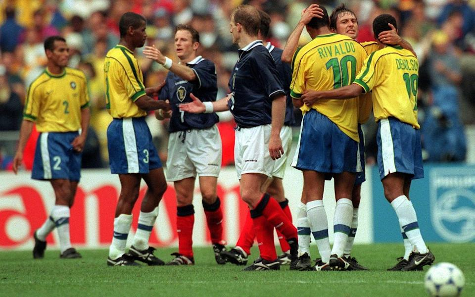 1998 World Cup Group A - Brazil v Scotland - Stade de France - 10/6/98 Pic : Stuart Franklin / Action Images Brazil & Scotland players embrace eachother at the end of the game - Stuart Franklin / Action