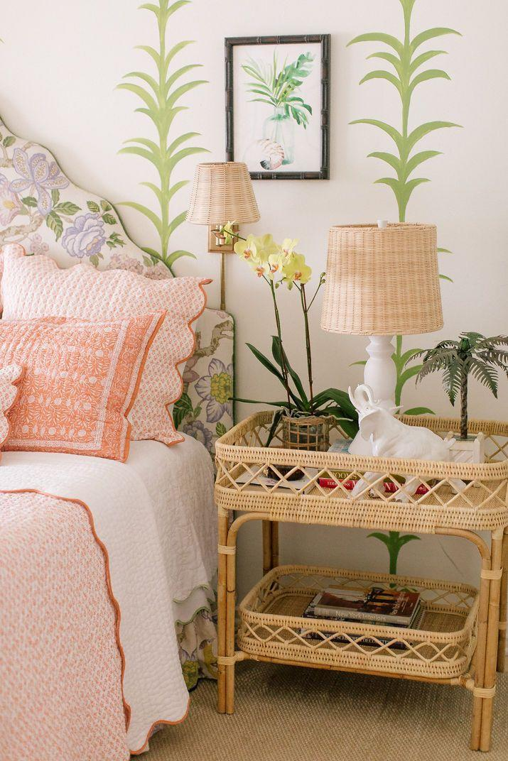 """<p>The queen of rattan, interior designer <a href=""""https://www.veranda.com/home-decorators/a32128482/amanda-lindroth-new-furniture-collection/"""" rel=""""nofollow noopener"""" target=""""_blank"""" data-ylk=""""slk:Amanda Lindroth"""" class=""""link rapid-noclick-resp"""">Amanda Lindroth</a>, lets her <a href=""""https://amandalindroth.com/products/lyford-bar-table?_pos=2&_sid=a0e067aa3&_ss=r"""" rel=""""nofollow noopener"""" target=""""_blank"""" data-ylk=""""slk:Lyford bar table"""" class=""""link rapid-noclick-resp"""">Lyford bar table</a> from her brand-new <a href=""""https://amandalindroth.com/collections/amanda-lindroth-home"""" rel=""""nofollow noopener"""" target=""""_blank"""" data-ylk=""""slk:furniture collection"""" class=""""link rapid-noclick-resp"""">furniture collection</a> serve more than one purpose — like as an island-chic nightstand. </p><p>""""I have been fascinated by people's night tables since I was a young girl. Doesn't it just say so much about a person by what is on their night table?"""" says the Bahamas-based Lindroth. </p><p>""""When we dress night tables for clients, we have a cup with matching pens and a stack of notecards or little tablets, a carafe of water with a glass with a pretty linen napkin on a rattan or lacquer tray, [and] an orchid in a rattan basket or a tiny posy of flowers from the garden."""" </p><p>This handwoven table's design was inspired by a vintage piece the designer has at her home, Hope Hill. <br></p>"""