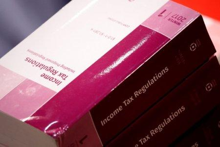 Copies of tax legislation are seen during a markup on the