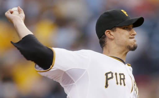Pittsburgh Pirates starting pitcher Charlie Morton throws against the Miami Marlins in the first inning of a baseball game on Wednesday, Aug. 7, 2013, in Pittsburgh. (AP Photo/Keith Srakocic)