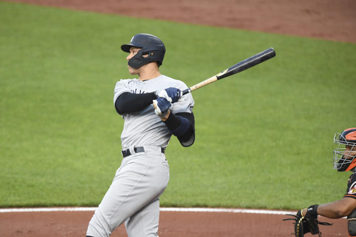 New York Yankees' Aaron Judge watches his first-inning home run hit off Baltimore Orioles starting pitcher Dean Kremer during a baseball game on Friday, May 14, 2021, in Baltimore. (AP Photo/Terrance Williams)