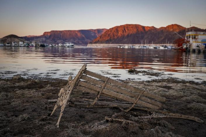 A formerly sunken bench rests on the shore near the Hemenway Harbor launch ramp on Lake Mead in Nevada.