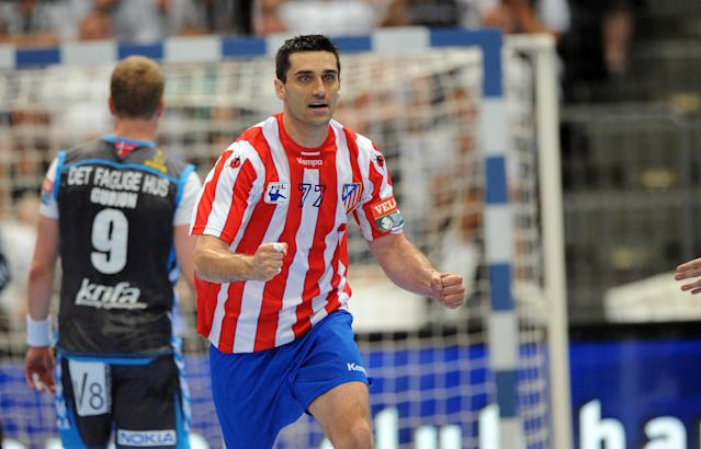 Madrid's Kiril Lazarov celebrates during the Handball Champions League EHF Final Four semi final match BM Atletico Madrid vs AG Kobenhavn on May 26, 2012 in Cologne, western Germany. Madrid won the match 25-23. AFP PHOTO JONAS GUETTLER GERMANY OUTJONAS GUETTLER/AFP/GettyImages