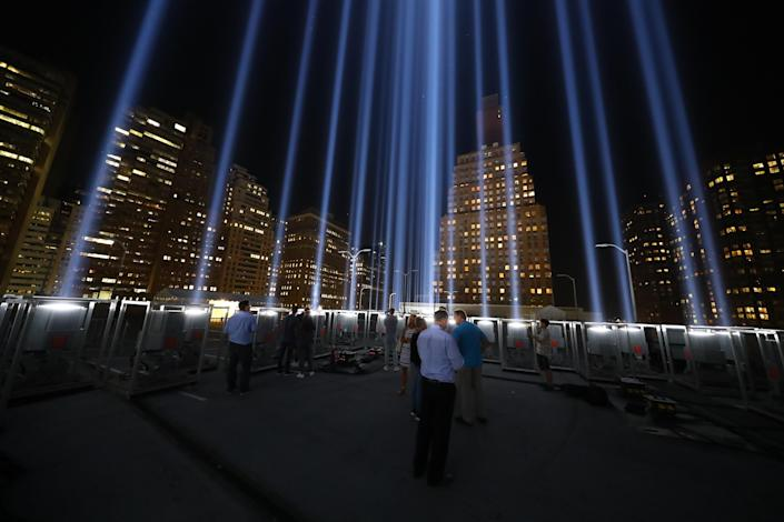 <p>The Tribute in Light rises above the New York City skyline from a rooftop on Sept. 5, 2018. (Photo: Gordon Donovan/Yahoo News) </p>