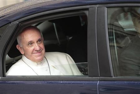Pope Francis leaves at the end of a private visit at the Church of the Gesu in Rome