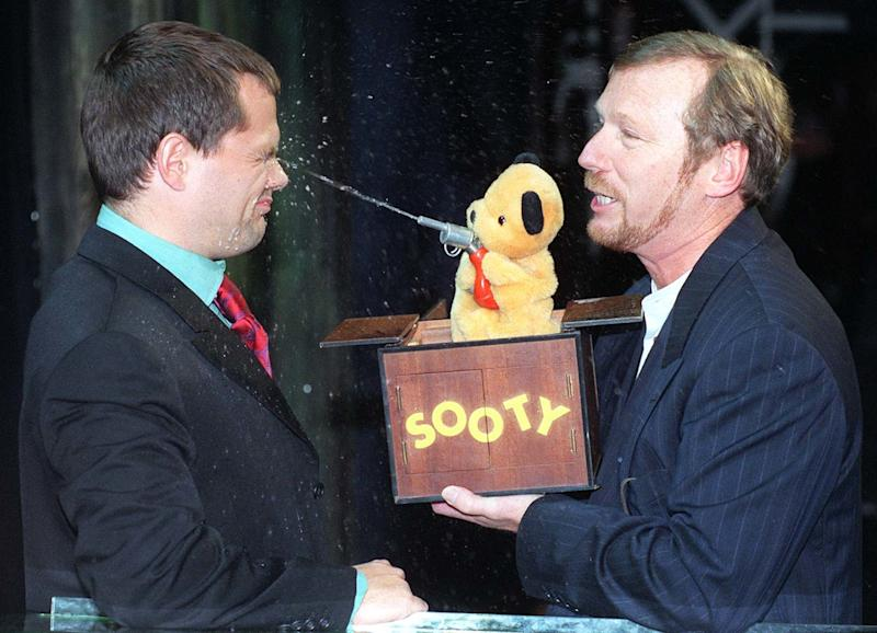 Comedian Jack Dee gets an eyeful from Sooty and puppeteer Matthew Corbett, at the launch today (Monday) of ITV's autumn schedules. Photo by Neil Munns/PA