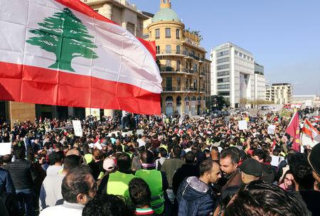 FILE PHOTO: People take part in a protest over the Lebanon's economy and politics in Beirut, Lebanon December 23, 2018. REUTERS/Mohamed Azakir/File Photo