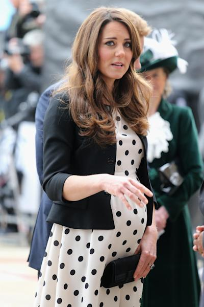 """Britain's Kate the Duchess of Cambridge arrives with her husband Prince William and his brother Prince Harry, both not pictured, to attend the inauguration of """"Warner Bros. Studios Leavesden"""" near Watford, approximately 18 miles north west of central London, Friday, April 26, 2013. As well as attending the inauguration Friday at the former World War II airfield site, the royals will undertake a tour of Warner Bros. """"Studio Tour London - The Making of Harry Potter"""", where they will view props, costumes and models from the Harry Potter film series. (AP Photo/Chris Jackson, Pool)"""