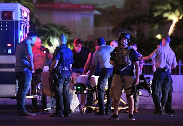 <p>Police officers stand by as medical personnel tend to a person on Tropicana Ave. near Las Vegas Boulevard after a mass shooting at a country music festival nearby on Oct. 2, 2017 in Las Vegas, Nevada. (Photo: Ethan Miller/Getty Images) </p>