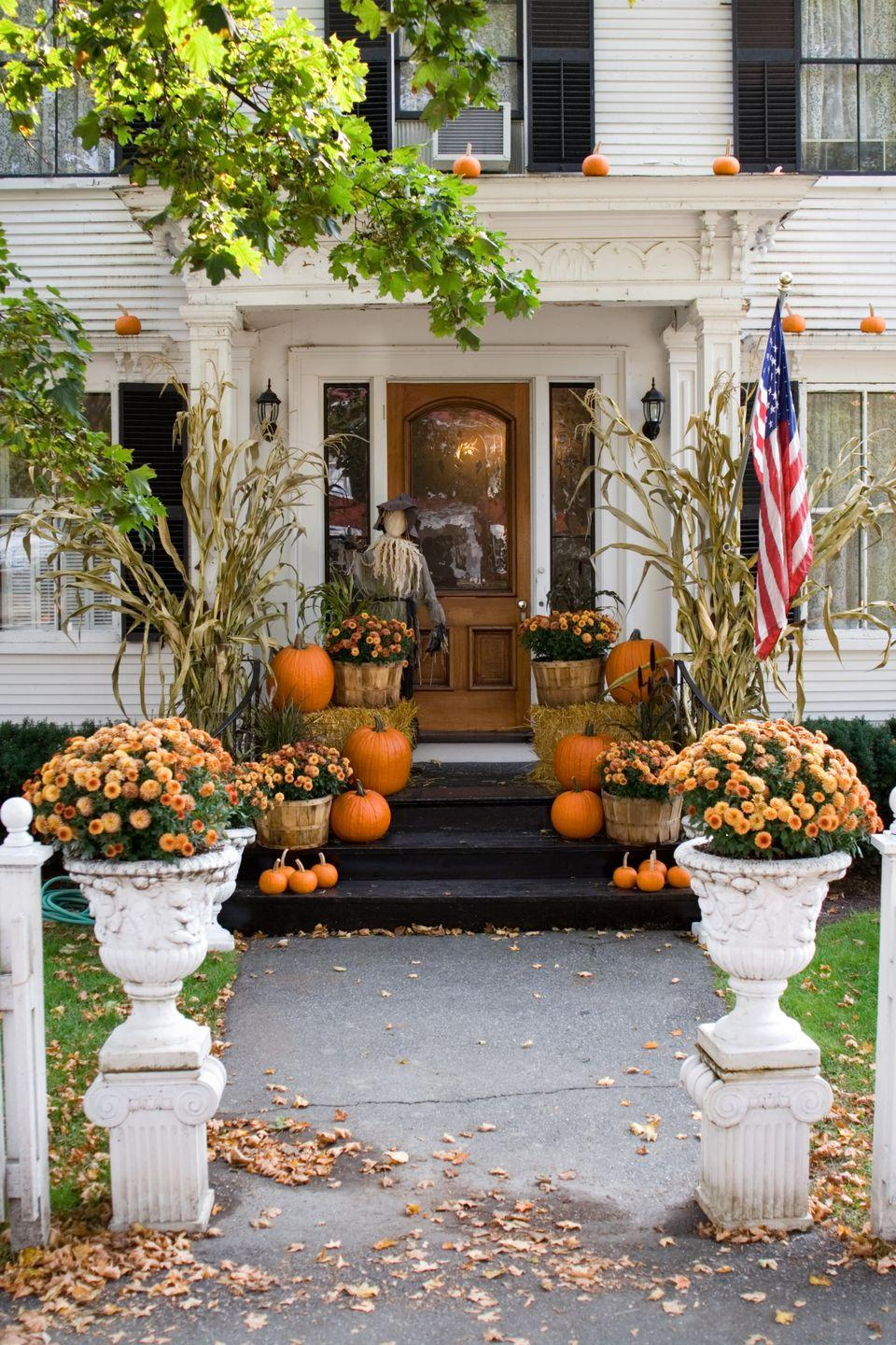 <p>Think beyond the front stoop and stick mini pumpkins in unexpected places, like on top of window sills.</p>