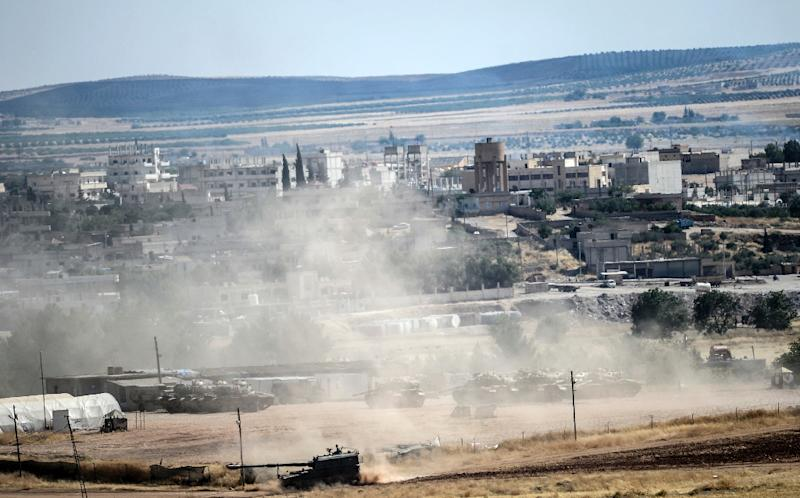 The jihadists had entered Kobane at dawn on Thursday disguised in YPG uniforms and seized several buildings in the south and southwest of the town (AFP Photo/Bulent Kilic)