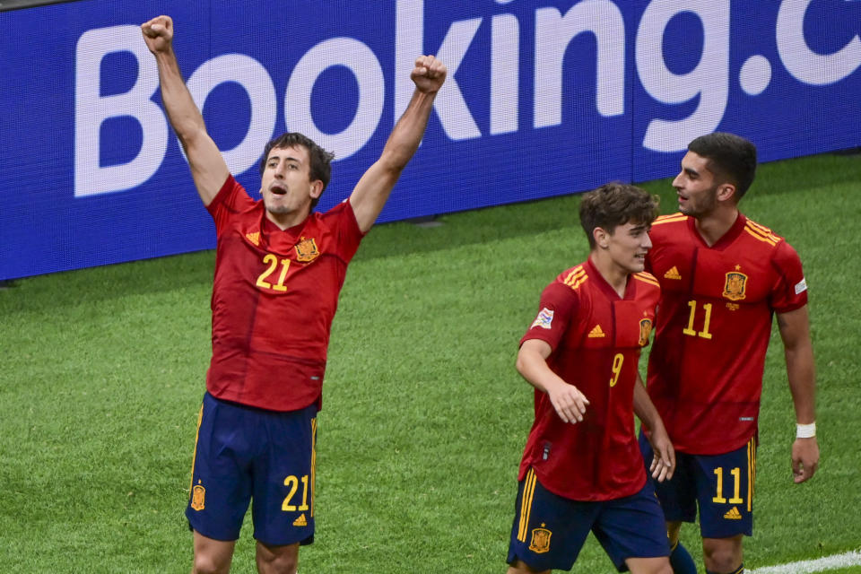 Spain's Mikel Oyarzabal, left, celebrates after scoring his team's first goal during the UEFA Nations League final soccer match between Spain and France at the San Siro stadium, in Milan, Italy, Sunday, Oct. 10, 2021. (Miguel Medina/Pool Photo via AP)