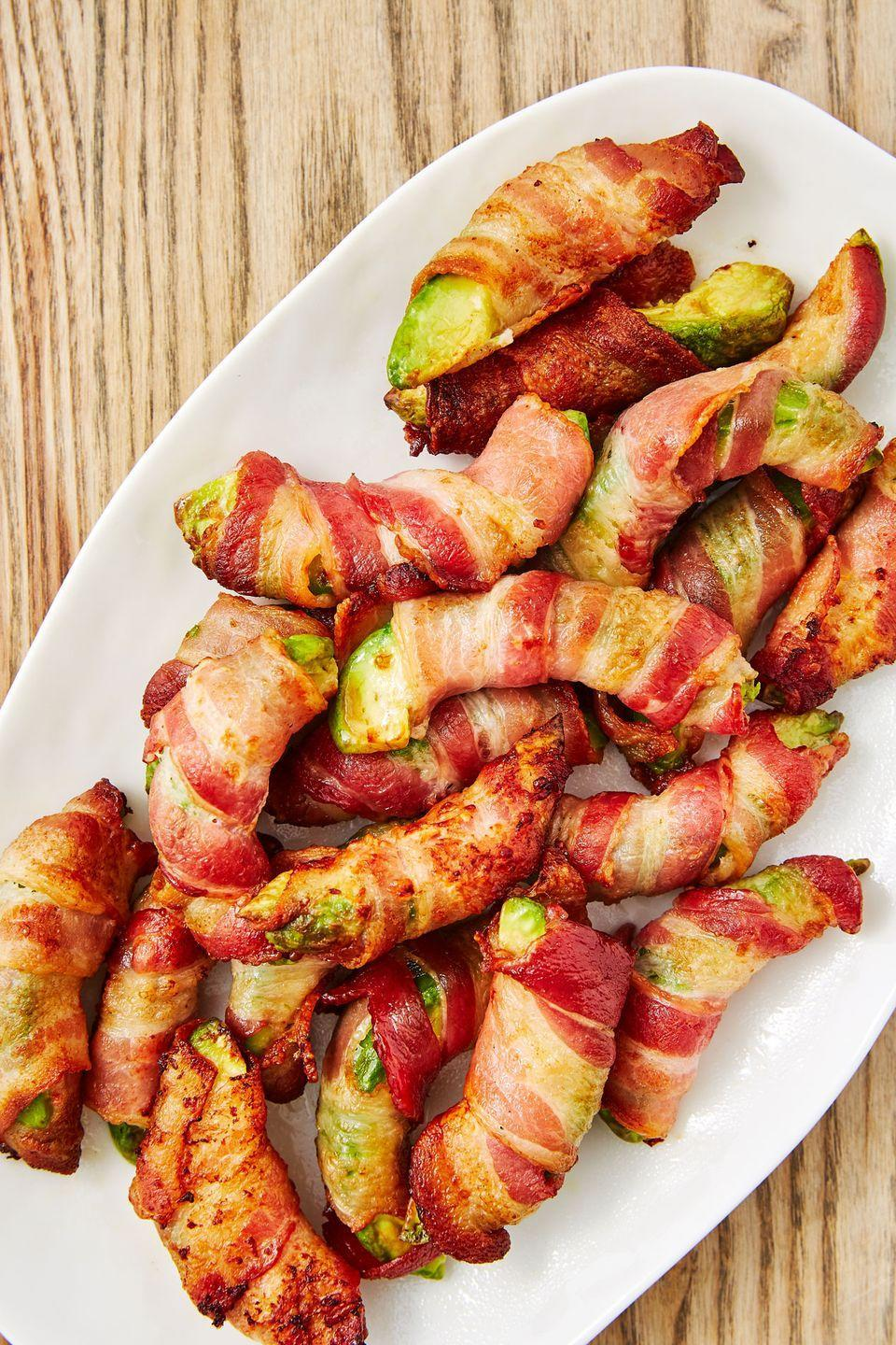 """<p>They're low-carb!! Eat your heart out!!!</p><p>Get the recipe from <a href=""""https://www.delish.com/cooking/recipe-ideas/recipes/a48261/bacon-avocado-fries-recipe/"""" rel=""""nofollow noopener"""" target=""""_blank"""" data-ylk=""""slk:Delish"""" class=""""link rapid-noclick-resp"""">Delish</a>.</p>"""