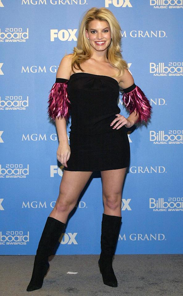 2000 was not a good year in fashion for Jessica Simpson, who had yet to hire Annabel Tollman as her stylist. At that year's Billboard Music Awards, Jess stepped out in a seriously short little black dress and knee-high black boots. A lot of skin, yes, but still cute. What sent this look over the edge were the feathers-cum-floaties adorning her arms. While she didn't fly away, her name flew onto a number of worst-dressed lists.