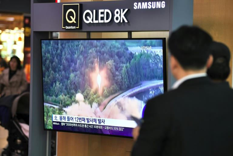 South Koreans watch footage of a North Korean missile launch shown at a railway station in Seoul in October 2019 (AFP Photo/Jung Yeon-je)