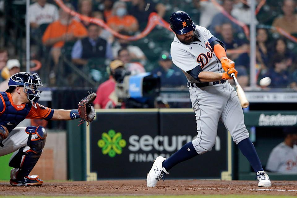Detroit Tigers' Renato Nunez hits a two-run home run in front of Houston Astros catcher Jason Castro during the fourth inning Tuesday, April 13, 2021, in Houston.