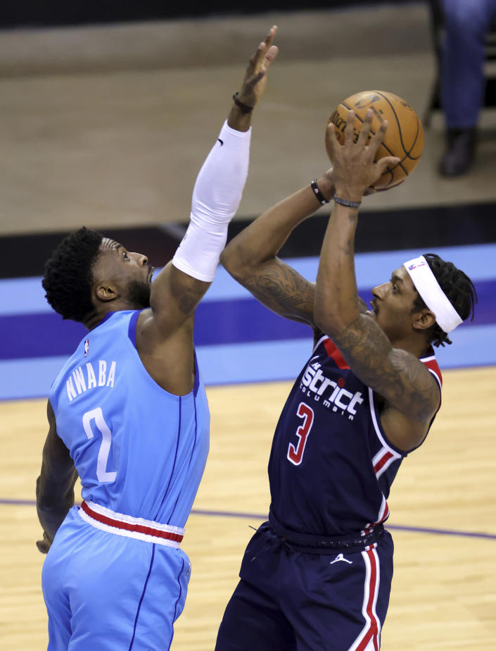 Washington Wizards' Bradley Beal, right, is defended by Houston Rockets' David Nwaba during the first quarter of an NBA basketball game Tuesday, Jan. 26, 2021, in Houston. (Carmen Mandato/Pool Photo via AP)