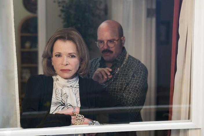 """Jessica Walter and David Cross peering out of a window in """"Arrested Development."""""""