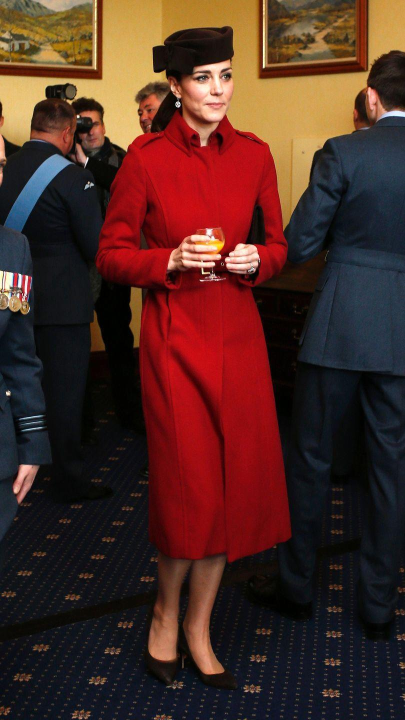 <p>Orange juice for the duchess during a reception for the RAF Search and Rescue Force in Anglesey, north Wales. She wore a favourite hat with her L.K. Bennett coat. </p>