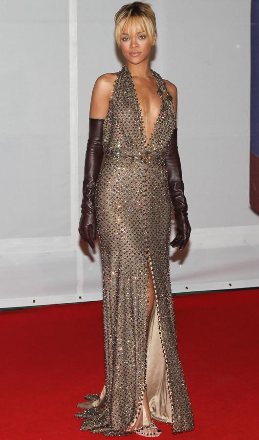 Celebrity fashion gold dresses: Rihanna rocked the look her way, naturally! At the BRITs she went for a deep gold with bronze sequins finished off with a plunging neckline.