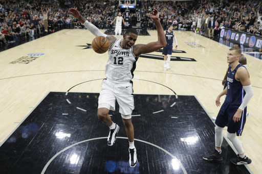 FILE - In this March 10, 2020, file photo, San Antonio Spurs forward LaMarcus Aldridge (12) celebrates as he scores against the Dallas Mavericks during the second half of an NBA basketball game in San Antonio. Aldridge will miss the remainder of San Antonios season while he recovers from surgery on his right shoulder. (AP Photo/Eric Gay, File)