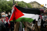 A protester waves a flag during a protest in solidarity with Palestinians, in Paris, Wednesday, May 12, 2021. (AP Photo/Thibault Camus)