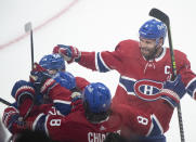 Montreal Canadiens celebrate a goal by Cole Caufield against the against Vegas Golden Knights during the second period of Game 3 of an NHL hockey semifinal series, Friday, June 18, 2021, in Montreal. (Graham Hughes/The Canadian Press via AP)