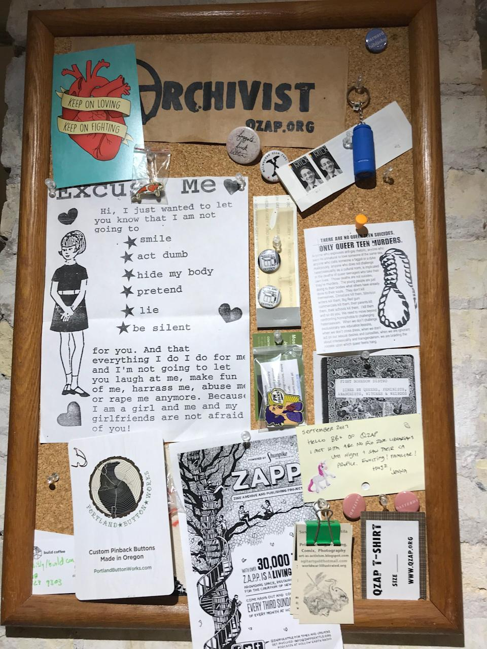 Mementos and zine clippings hang on a board at the Queer Zine Archive Project. Zines have deep roots in queer communities, said Milo Miller, cofounder of QZAP.