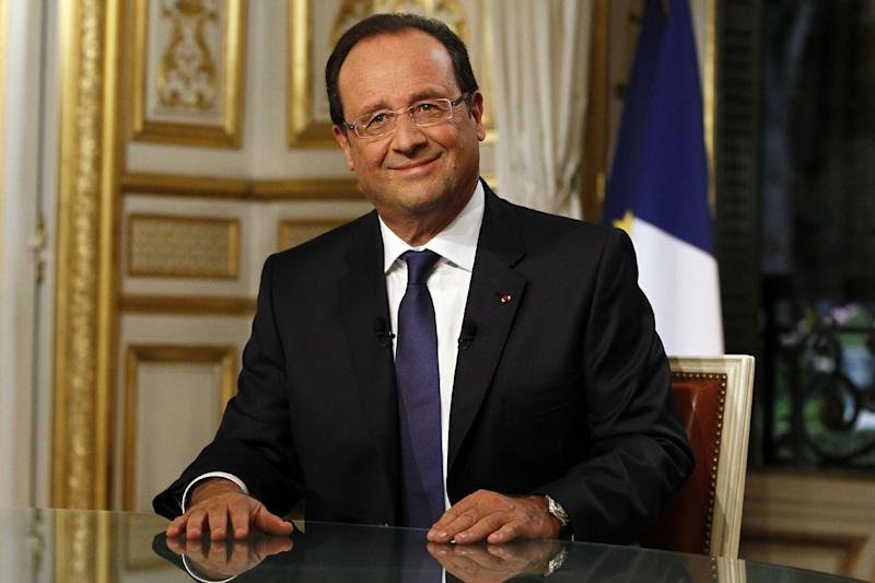 """French President Francois Hollande takes part in a televised interview on a French TV channel, in Paris, Sunday, Sept. 15, 2013. In a televised address Sunday night, Hollande said: """"The military option must remain; otherwise there will be no pressure."""" (AP Photo/Francois Mori, pool)"""