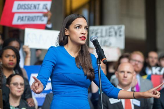 Alexandria Ocasio-Cortez speaks at a rally calling on Sen. Jeff Flake (R-AZ) to reject Judge Brett Kavanaugh's nomination to the Supreme Court on 1 October 2018 in Boston, Massachusetts (Getty Images)