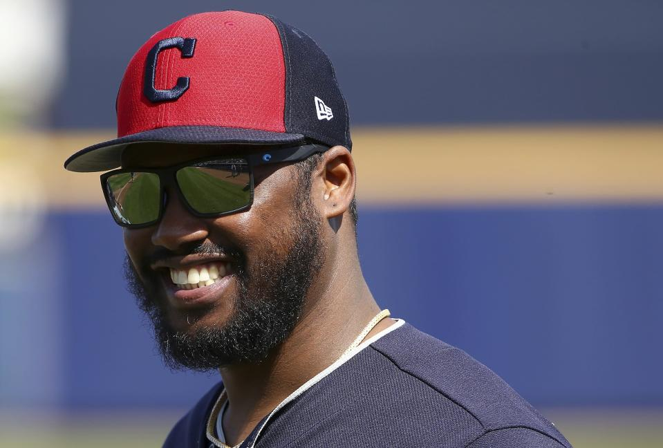 Cleveland Indians' Hanley Ramirez smiles as he arrives on the field prior to a spring training baseball game against the San Diego Padres, Monday, March 4, 2019, in Peoria, Ariz. (AP Photo/Ross D. Franklin)