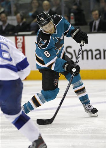 San Jose Sharks center Joe Pavelski (8) takes a shot at goal against the Tampa Bay Lightning during the second period of an NHL hockey game in San Jose, Calif., Wednesday, Dec. 21, 2011. (AP Photo/Tony Avelar)