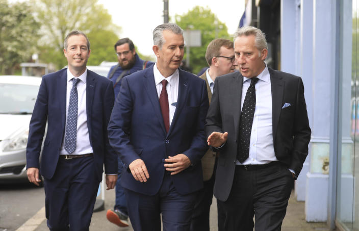 Democratic Unionist Party members Edwin Poots, centre, Paul Girvan, left, and Ian Paisley jnr leave the party headquarters in east Belfast after voting took place to elect a new leader on Friday May 14, 2021. Edwin Poots and Jeffrey Donaldson are running to replace Arlene Foster. (AP Photo/Peter Morrison)