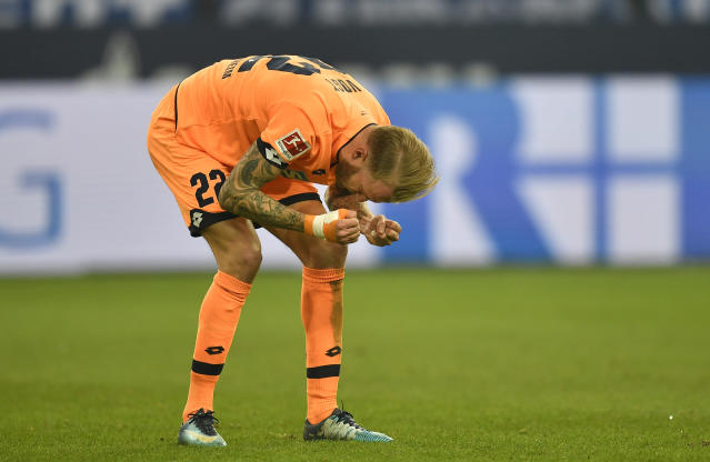 Hoffenheim's Kevin Vogt reacts disappointed during the German Bundesliga soccer match between FC Schalke 04 and TSG Hoffenheim in Gelsenkirchen, Germany, Saturday, Feb. 17, 2018. (AP Photo/Martin Meissner)