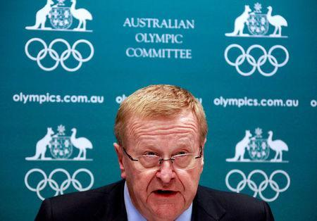 FILE PHOTO - John Coates, President of the Australian Olympic Committee (AOC), reacts as he announces the findings of a probe into the conduct of Australian swimming team members in the run-up to the 2012 London Games, at a media conference in Sydney August 23, 2013. REUTERS/David Gray/File Photo