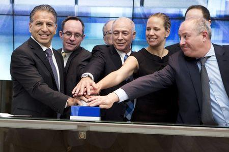 Robert J. Coury, Chairman and Chief Executive Officer of Mylan (L) participates in a bell ringing ceremony with officials at the Tel Aviv Stock Exchange, Israel November 4, 2015. REUTERS/Nir Elias