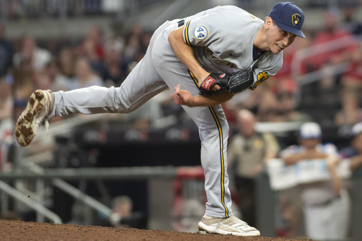 Milwaukee Brewers Brent Suter follows through on a delivery to an Atlanta Braves batter during the ninth inning of a baseball game Friday, July 30, 2021, in Atlanta. (AP Photo/Hakim Wright Sr.)