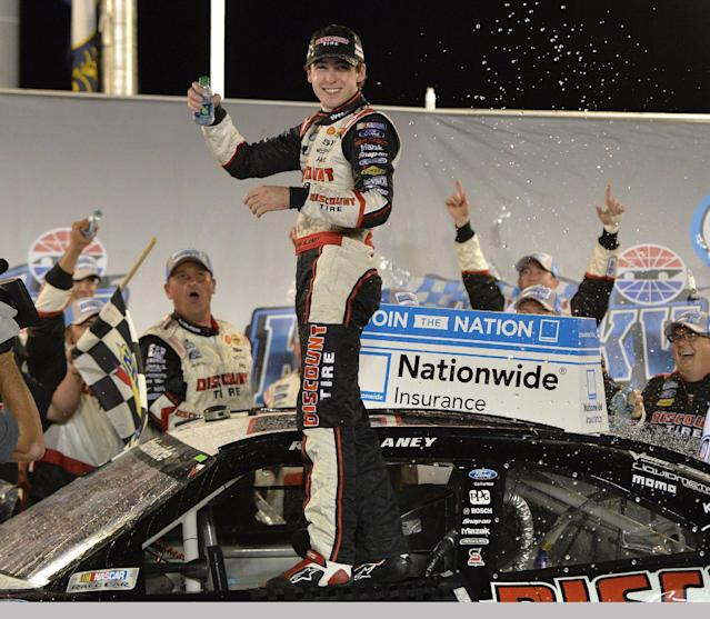 Ryan Blaney celebrates after winning the NASCAR Nationwide Series auto race, Saturday, Sept. 21, 2013, at Kentucky Speedway in Sparta, Ky. (AP Photo/Timothy D. Easley)