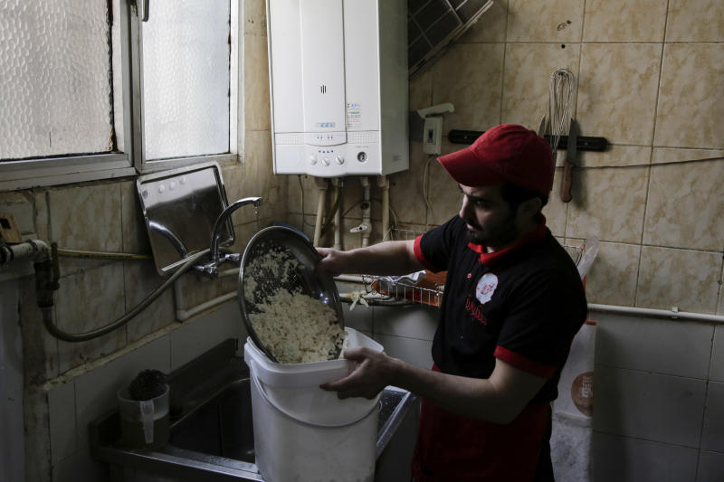 A Syrian worker prepared Syrian baklava pastry in a pastry shop in the 'Little Syria', the nickname for Istanbul's Aksaray neighbourhood, now home to many Syrians who escaped the civil war that has ravaged the country for the past six years, Saturday, April 8, 2017. Restaurants and shops with colorful Arabic signs offer respite to those who sorely miss their country and its delicacies.The country hosts three million Syrian refugees and its largest city, Istanbul, is home to some 480,000 of them. (AP Photo/Bram Janssen)