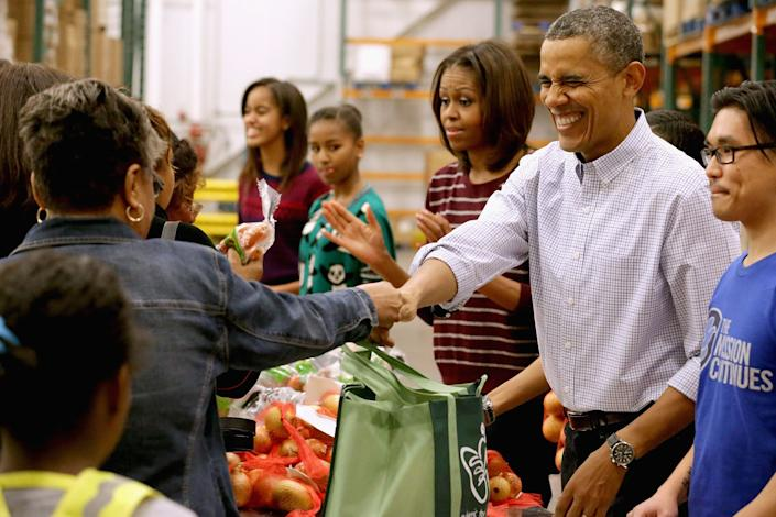 The Obamas packed and distributed bags of food at the Capital Area Food Bank in Washington, DC, in 2013. (Photo: WHITE HOUSE POOL (ISP POOL IMAGES) via Getty Images)