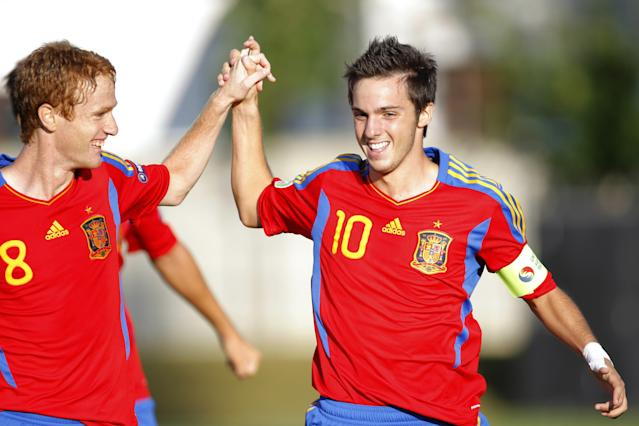 Pablo Sarabia (R) of Spain celebrates with Alex (L) after he scored 1-0 against Belgium during their UEFA European Under-19 Championship 2010/2011 football final tournament in Mogosoaia village, next to Bucharest on July 21, 2011. AFP PHOTO/ STRINGER (Photo credit should read -/AFP/Getty Images)
