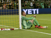 Austin FC goalkeeper Brad Stuver sits against the goal after a loss to the San Jose Earthquakes in an MLS soccer match, Saturday, Sept. 18, 2021, in Austin, Texas. (AP Photo/Michael Thomas)
