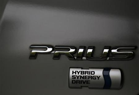 The logo of Toyota Motor Corp's Prius hybrid car is seen on its body at the company's showroom in Tokyo